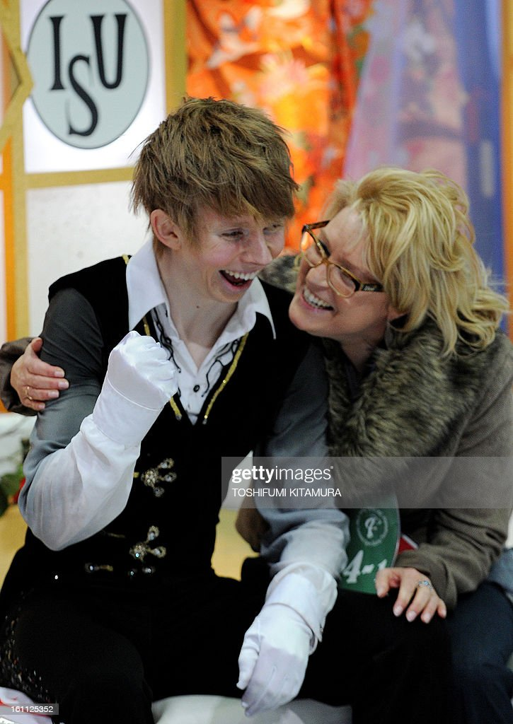 Canada's Kevin Reynolds (L) clinches his fist alongside his coach after his free skating performance in the men's event during the Four Continents figure skating championships in Osaka on February 9, 2013.