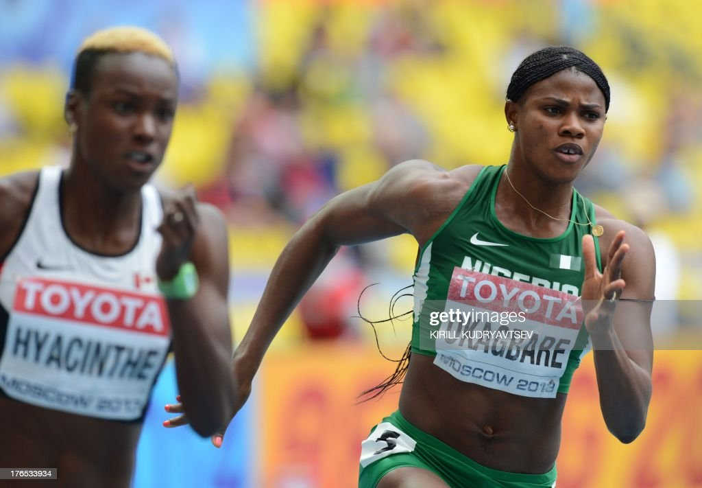 Canada's Kimberly Hyacinthe and Nigeria's Blessing Okagbare compete during the women's 200 metres event at the 2013 IAAF World Championships at the Luzhniki stadium in Moscow on August 15, 2013.