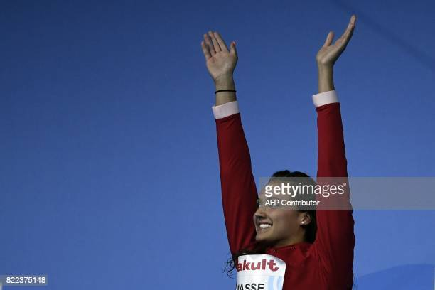 Canada's Kylie Jacqueline Masse celebrates on the podium after the women's 100m backstroke final during the swimming competition at the 2017 FINA...