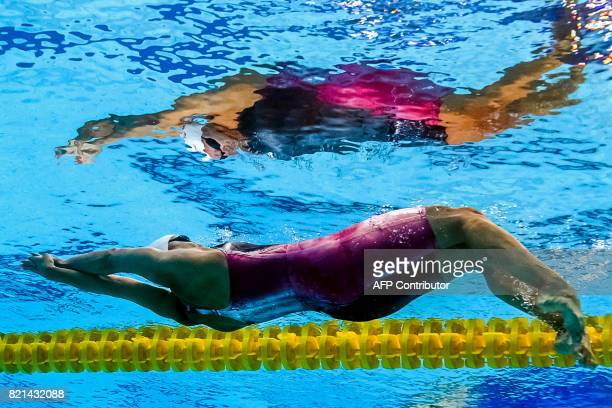 Canada's Kylie Jacqueline Masse competes in a heat of the women's 100M Backstroke during the swimming competition at the 2017 FINA World...