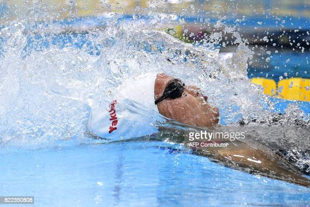 Canada's Kylie Jacqueline Masse competes in the women's 100m backstroke final during the swimming competition at the 2017 FINA World Championships in...