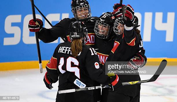 Canada's MariePhilip Poulin celebrates with her teammates after scoring during the Women's Ice Hockey Group A match Canada vs Switzerland at the...