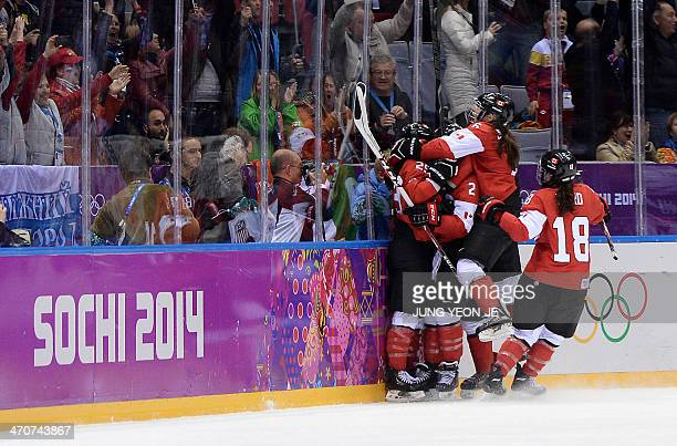 Canada's MariePhilip Poulin celebrates with teammates after scoring during the Women's Ice Hockey Gold Medal Game between Canada and USA at the...