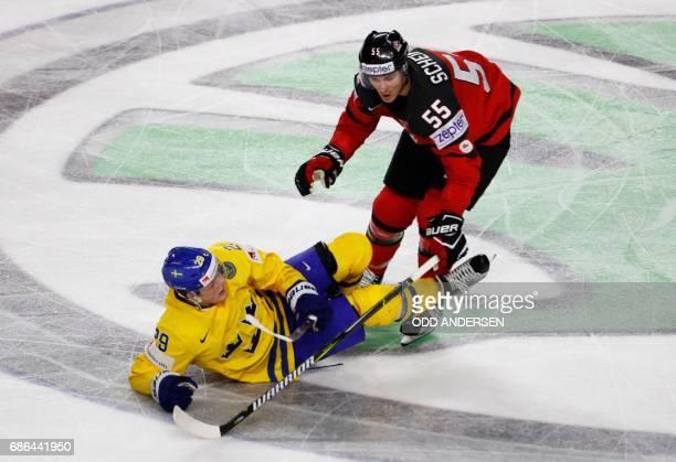 Canada's Mark Scheifele and Sweden's William Nylander vie during the IIHF Men's World Championship Ice Hockey final match between Canada and Sweden...