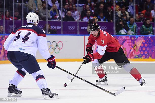 Canada's Matt Duchene vies with US Brooks Orpik during the Men's Ice Hockey Semifinals USA vs Canada at the Bolshoy Ice Dome during the Sochi Winter...