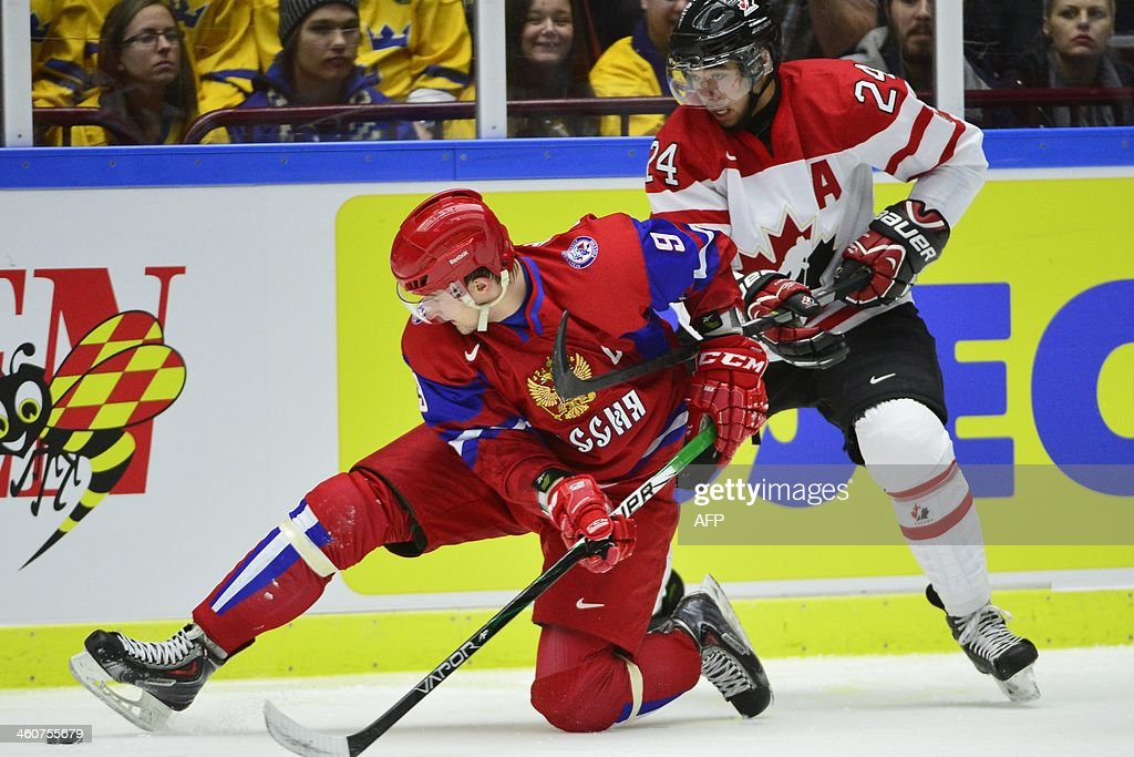 Canada's Matt Dumba (R) vies with Russia's Anton Slepyshev during the World Junior Hockey Championships bronze medal match between Canada and Russia at Malmo Arena in Malmo, Sweden on January 5, 2014.