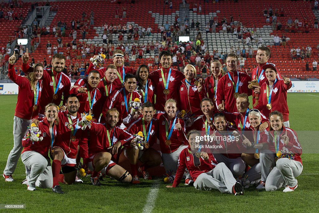 TORONTO, - JULY 12, 2015 - Canada's Men's and Women's teams gather for a picture after both won Gold in Rugby 7s. Toronto 2015 Pan Am coverage. Photographed on JULY 12, 2015. Canada won 22-19.