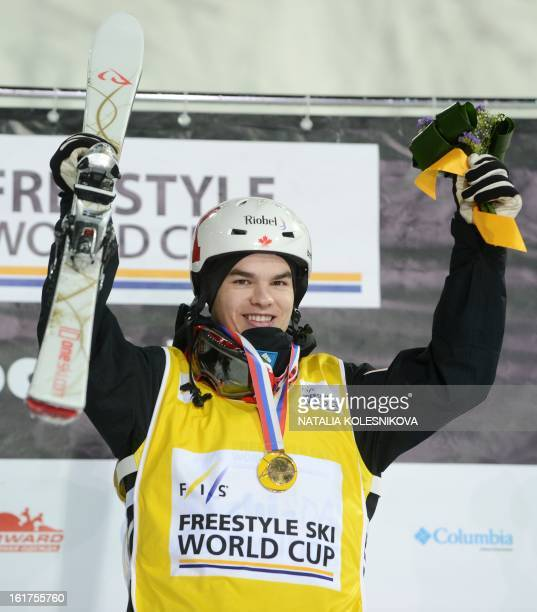 Canada's Mikael Kingsbury celebrates on the podium his first place after the Freestyle Ski World Cup Men's Moguls Test Event at the Snowboard and...