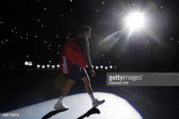 Canada's Milos Raonic arrives for his quarterfinal match against Switzerland's Roger Federer at the ATP World Tour Masters 1000 indoor tennis...