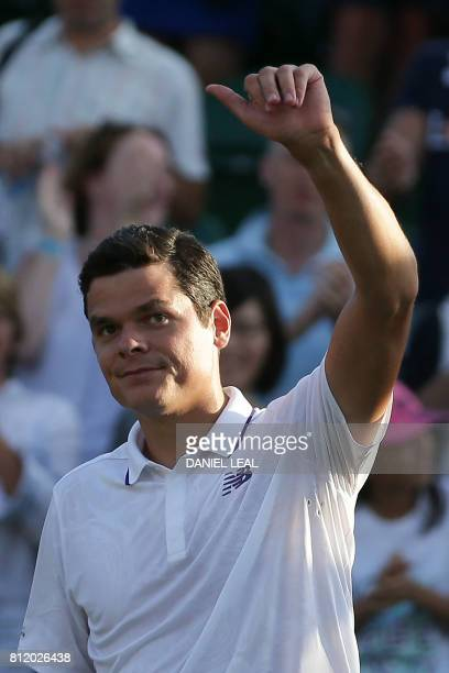 Canada's Milos Raonic celebrates after beating Germany's Alexander Zverev during their men's singles fourth round match on the seventh day of the...