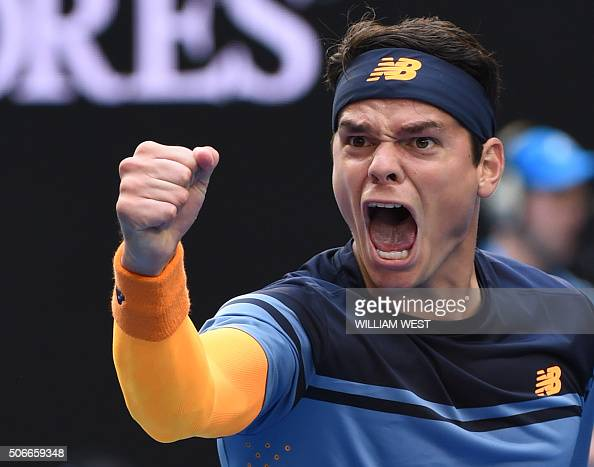 TOPSHOT Canada's Milos Raonic celebrates after victory in his men's singles match against Switzerland's Stanislas Wawrinka on day eight of the 2016...