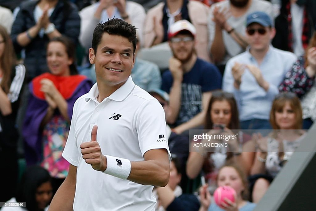 Canada's Milos Raonic celebrates beating Italy's Andreas Seppi during their men's singles second round match on the fourth day of the 2016 Wimbledon Championships at The All England Lawn Tennis Club in Wimbledon, southwest London, on June 30, 2016. / AFP / ADRIAN