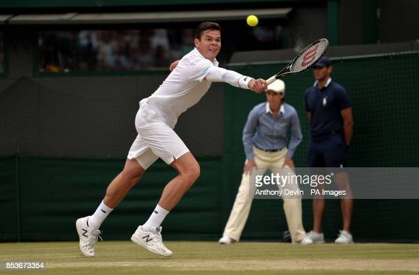 Canada's Milos Raonic in action against Australia's Nick Kyrgios during day ten of the Wimbledon Championships at the All England Lawn Tennis and...