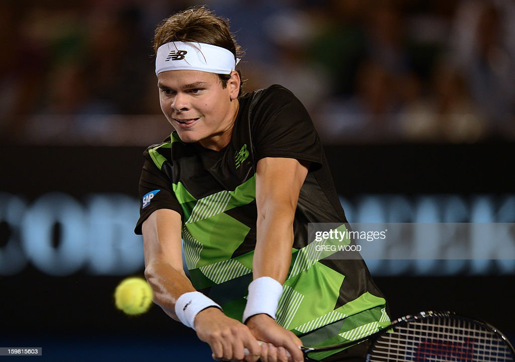 Canada's Milos Raonic plays a return during his men's singles match against Switzerland's Roger Federer on the eighth day of the Australian Open tennis tournament in Melbourne on January 21, 2013. AFP PHOTO/ GREG WOOD IMAGE STRICTLY RESTRICTED TO EDITORIAL USE - STRICTLY NO COMMERCIAL USE