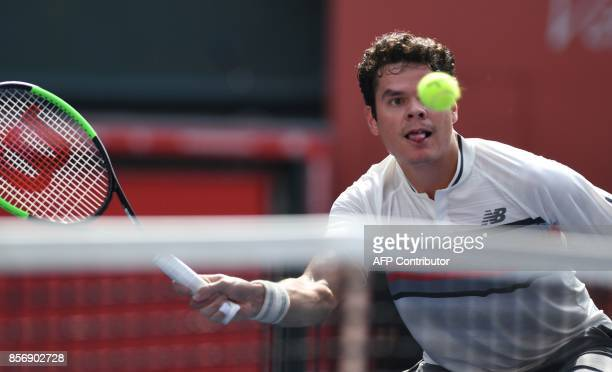 Canada's Milos Raonic prepares to return a shot to Serbian Viktor Troicki during their men's singles first round match at the Japan Open tennis...