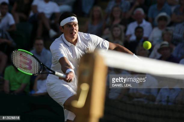 Canada's Milos Raonic returns against Germany's Alexander Zverev during their men's singles fourth round match on the seventh day of the 2017...