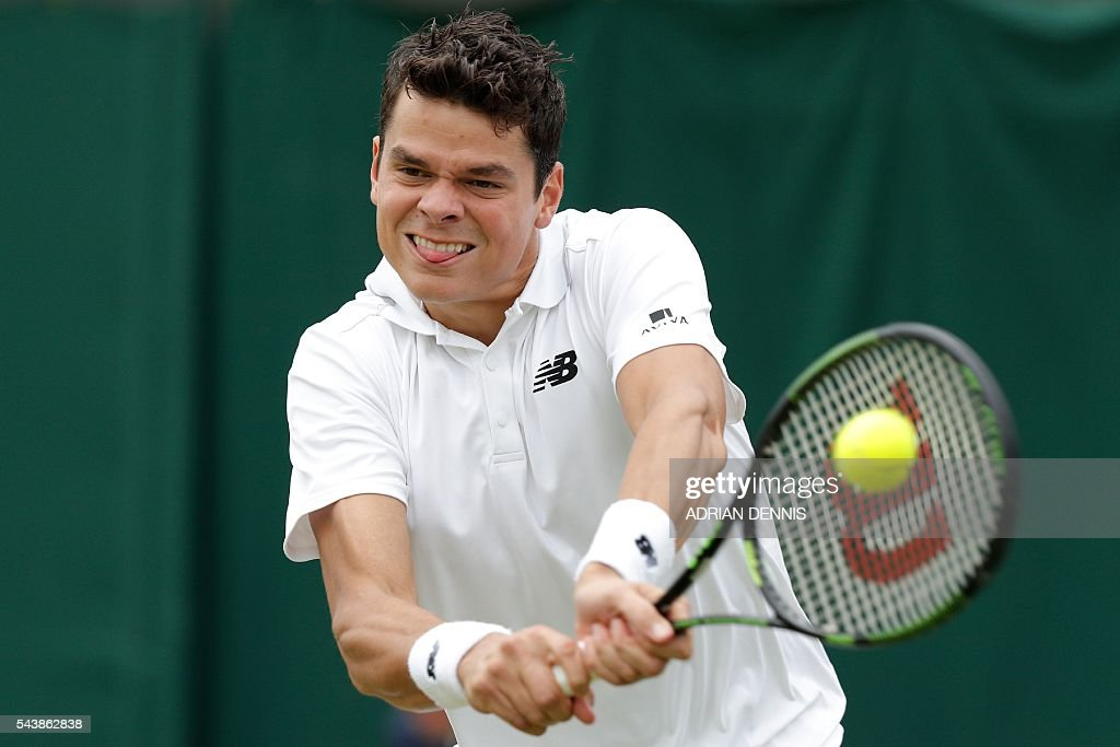 Canada's Milos Raonic returns against Italy's Andreas Seppi during their men's singles second round match on the fourth day of the 2016 Wimbledon Championships at The All England Lawn Tennis Club in Wimbledon, southwest London, on June 30, 2016. / AFP / ADRIAN