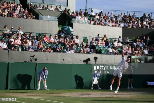 Canada's Milos Raonic serves against Germany's Alexander Zverev during their men's singles fourth round match on the seventh day of the 2017...