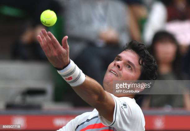 Canada's Milos Raonic serves against Serbian Viktor Troicki during their men's singles first round match at the Japan Open tennis tournament in Tokyo...