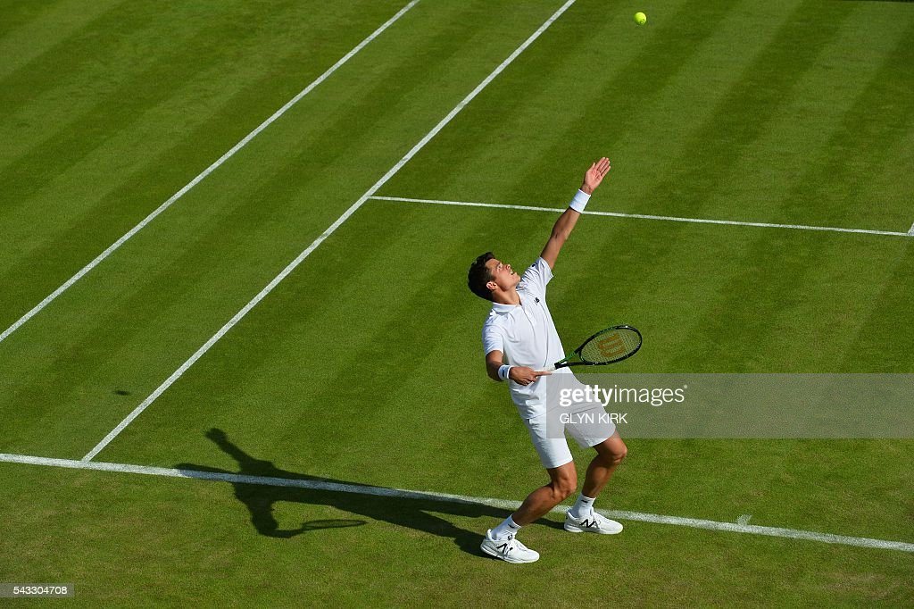 Canada's Milos Raonic serves against Spain's Pablo Carreno Busta during their men's singles first round match on the first day of the 2016 Wimbledon Championships at The All England Lawn Tennis Club in Wimbledon, southwest London, on June 27, 2016. / AFP / GLYN
