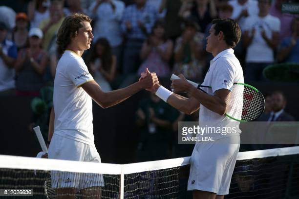 Canada's Milos Raonic shakes hands at the net with Germany's Alexander Zverev after Raonic won their men's singles fourth round match on the seventh...
