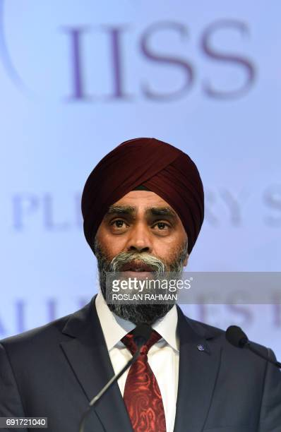 Canada's Minister of National Defence Harjit Singh Sajjan speaks during the third plenary session at the 16th Institute for Strategic Studies...