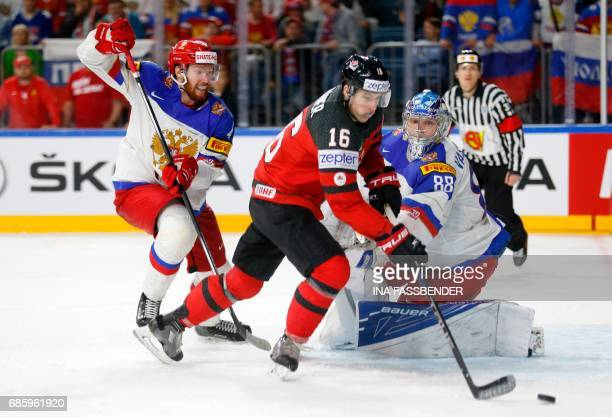Canada's Mitch Marner competes with Russia's Vladislav Gavrikov and goalkeeper Andrei Vasilevski during the IIHF Men's World Championship Ice Hockey...