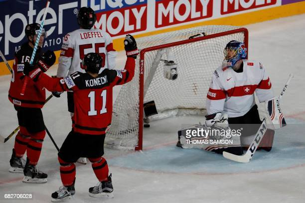 Canada's Mitch Marner is congratulated by Canada's Travis Konecny after scoring a goal during the IIHF Men's World Championship group B ice hockey...
