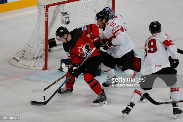 Canada's Mitch Marner scores a goal during the IIHF Men's World Championship group B ice hockey match between Canada and Switzerland in Paris on May...