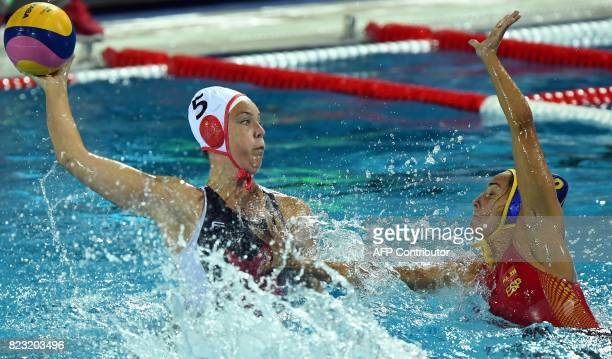 Canada's Monika Eggens scores a goal past Spain's Anna Espar Llaquet during the semifinal water polo match between Canada and Spain at the 2017 FINA...