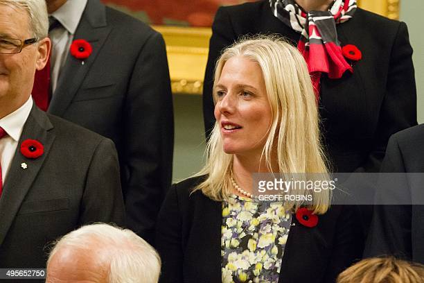 Canada's new environment minister Catherine McKenna poses for a photo with other cabinet members at Rideau Hall in Ottawa Ontario November 4 2015 AFP...