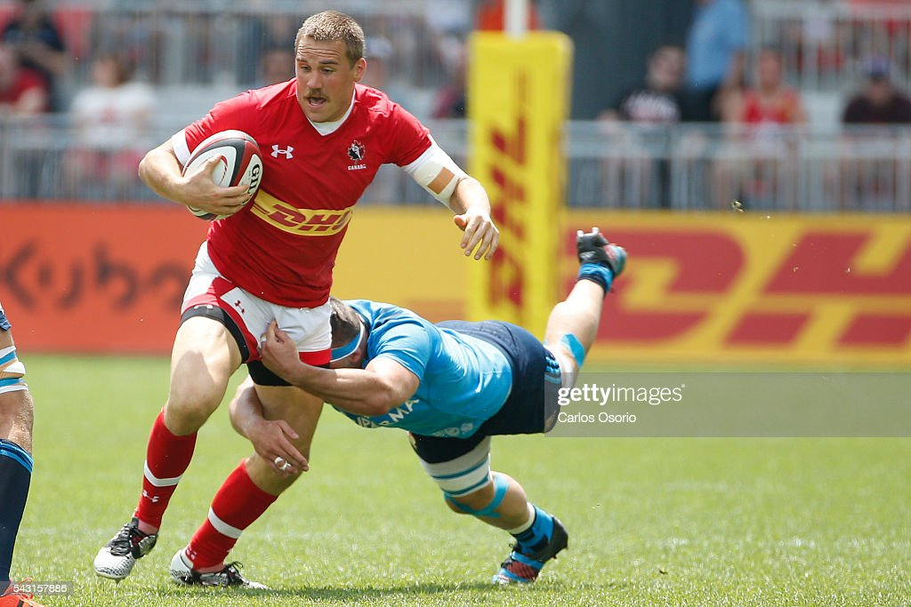 TORONTO, ON - JUNE 26 - Canada's Nick Blevins evades a tackle from Italy's Simone Favaro during the first half of Rugby action as Canadas Mens Rugby Team takes on Italy in a Rugby World Cup (RWC) 2015 re-match on Sunday at BMO field in downtown Toronto June 26, 2016.