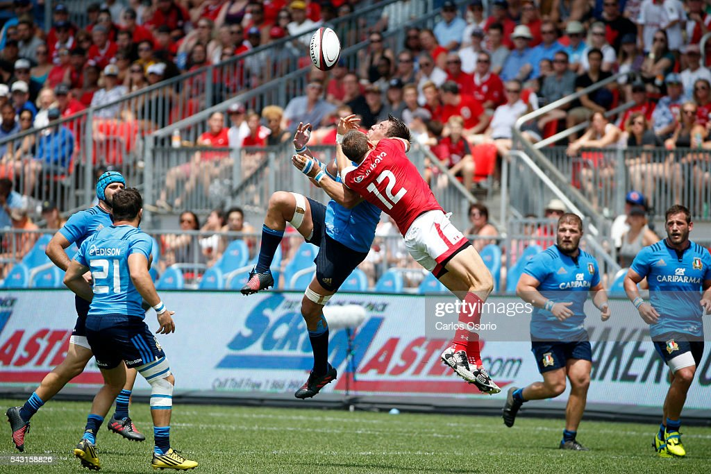 TORONTO, ON - JUNE 26 - Canada's Nick Blevins (12) jumps for a ball with Italy's Andries Van Schalkwyk during the second half of Rugby action as Canadas Mens Rugby Team takes on Italy in a Rugby World Cup (RWC) 2015 re-match on Sunday at BMO field in downtown Toronto.June 26, 2016. Italy defeated Canada 20-18