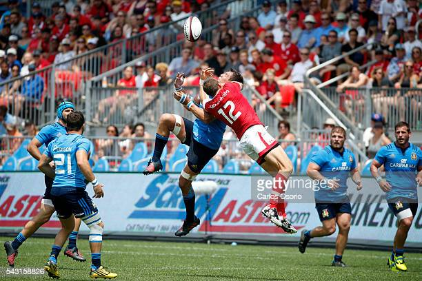 TORONTO ON JUNE 26 Canada's Nick Blevins jumps for a ball with Italy's Andries Van Schalkwyk during the second half of Rugby action as Canadas Mens...