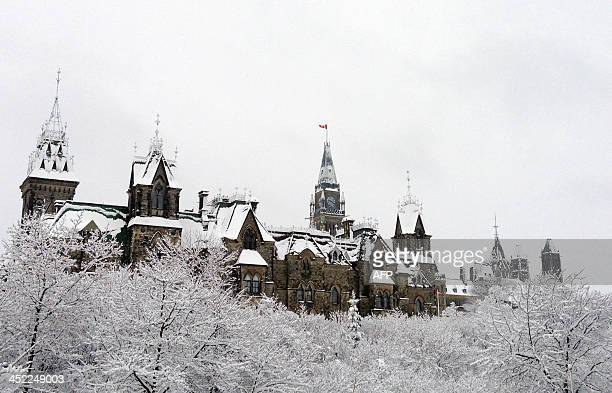 Canada's parliament was blanketed with snow overnight in Eastern Canada's first major snowfall of the winter in Ottawa Ontario on November 27 2013 A...