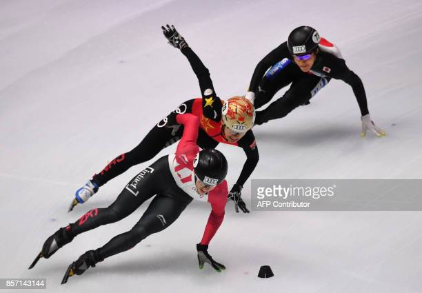 Canada's Pascal Dion China'a Xu Hongzhi and Japan's Kazuki Yoshinaga compete during the final competition in the 'Men 5000m Relay' category at the...