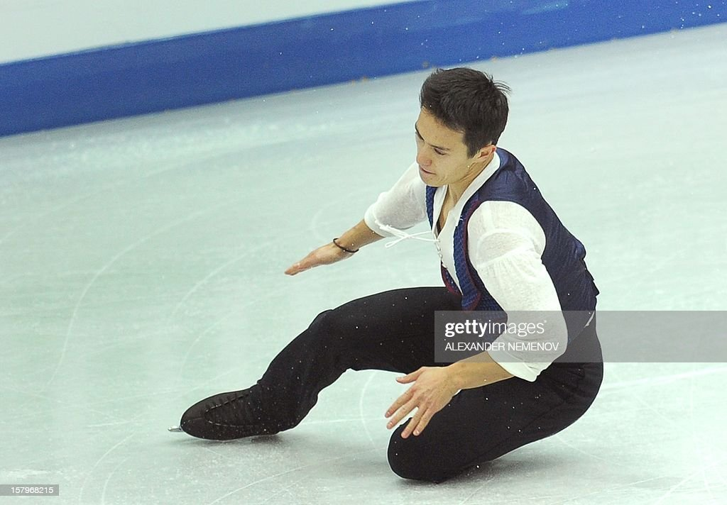 Canada's Patrick Chan falls down while performing for the bronze medal during men free skating event at the ISU Grand Prix of Figure Skating Final in Sochi on December 8, 2012.