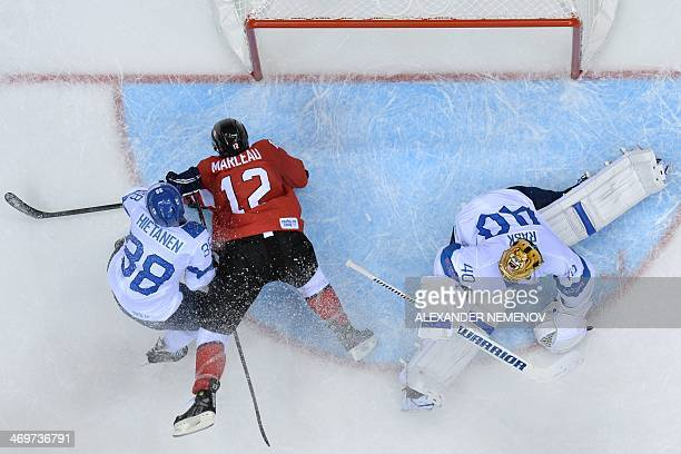 Canada's Patrick Marleau vies with Finland's goalkeeper Tuukka Rask and Finland's Juuso Hietanen during the Men's Ice Hockey Group B match Finland vs...