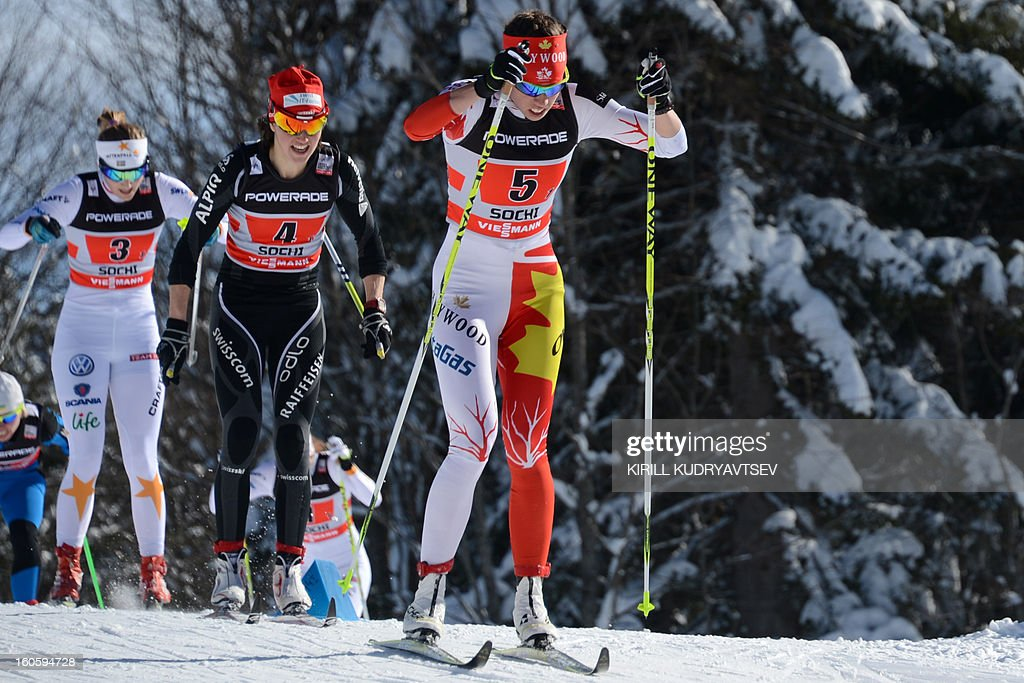 Canada's Perianne Jones (R) competes during 6 x 1,25 km Ladies' Classic Team Sprint of FIS Cross Country skiing World Cup at Laura Cross Country and Biathlon Center in Russian Black Sea resort of Sochi on February 3, 2013. Finland's Mona-Lisa Malvalehto and Anne Kylloenen took the first place ahead of Russia's Julia Ivanova and Natalia Matveeva and Canada's Perianne Jones and Daria Gaiazova. AFP PHOTO/KIRILL KUDRYAVTSEV