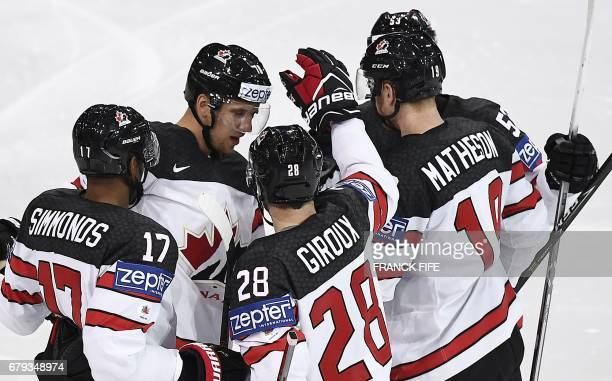 Canada's players celebrate a goal during the IIHF Men's World Championship group B ice hockey match between the Czech Republic and Canada in Paris on...