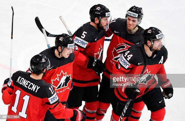 Canada's players celebrate after scoring a goal during the IIHF Men's World Championship Canada vs France group B ice hockey match on May 11 in Paris...