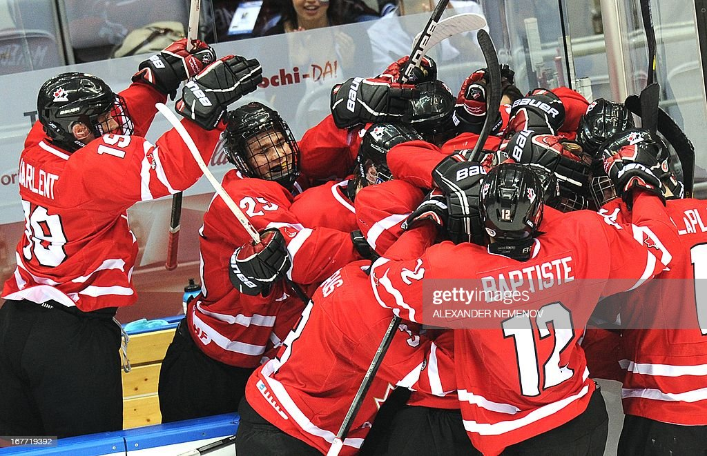 Canada's players celebrate after scoring against USA during the IIHF U18 International Ice Hockey World Championships final game in Sochi on April 28, 2013.