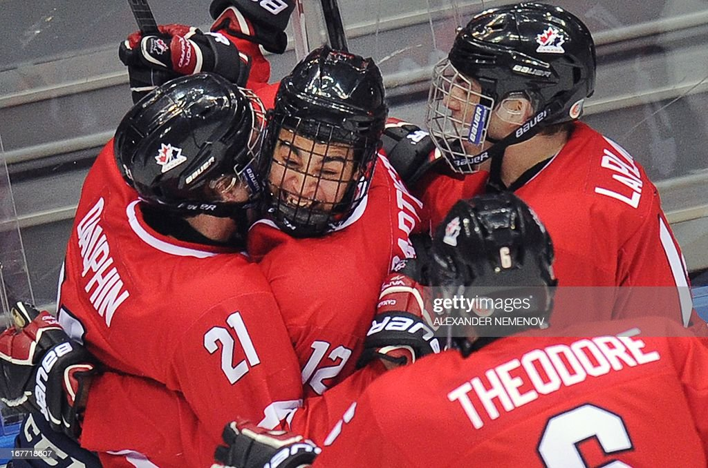 Canada's players celebrate after scoring during the IIHF U18 International Ice Hockey World Championships final game in Sochi on April 28, 2013. AFP PHOTO / ALEXANDER NEMENOV