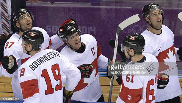 Canada's players celebrate after scoring during the Men's Ice Hockey Quarterfinals Canada vs Latvia at the Bolshoy Ice Dome during the Sochi Winter...