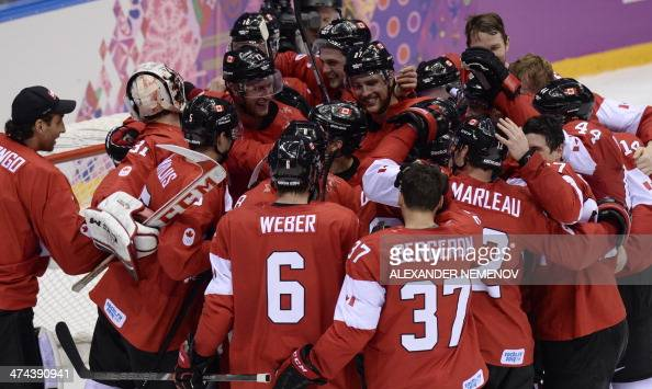 Canada's players celebrate after winning the Men's ice hockey final Sweden vs Canada at the Bolshoy Ice Dome during the Sochi Winter Olympics on...
