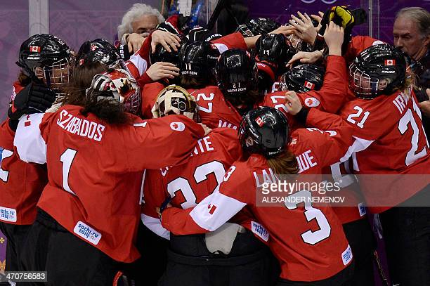 Canada's players celebrate after winning the Women's Ice Hockey Gold Medal Game between Canada and USA at the Bolshoy Ice Dome during the Sochi...