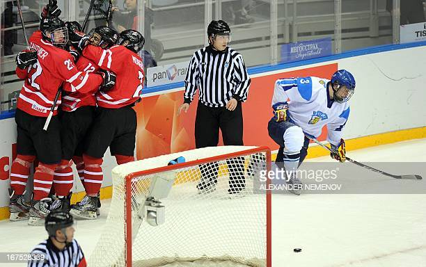 Canada's players celebrate their 21 victory over team Finland during a semifinal game of the IIHF U18 International Ice Hockey World Championship in...