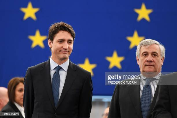 Canada's Prime Minister Justin Trudeau arrives with European Parliament President Antonio Tajani for a plenary session at the European Parliament in...