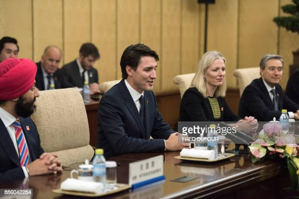Canada's Prime Minister Justin Trudeau listens to China's President Xi Jinping during a meeting at the Diaoyutai State Guesthouse on December 5 in...