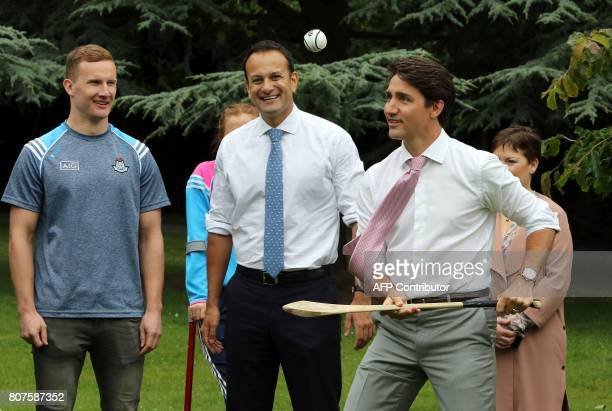 Canada's Prime Minister Justin Trudeau tries his hand at the sport of hurling watched by Ireland's Prime Minister Leo Varadkar at Farmleigh House in...